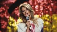 Die britische Rocksängerin Bonnie Tyler in den 70er Jahren bei einem Auftritt in der TV-Sendung Musikladen. © picture alliance / Jazz Archiv Fotograf: Hardy Schiffler