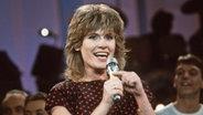 Mary Roos 1984 beim Vorentscheid für den Grand Prix d'Eurovision in München. © dpa Fotograf: Istvan Bajzat