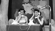 Telefonistinnen nehmen die Länderpunkte entgegen. Grand Prix 1957 in Frankfurt. © HR