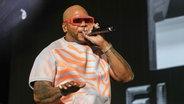 Der US-amerikanische Rapper Flo Rida auf einem Konzert 2019. © picture alliance/AP Images Foto: Robb Cohen