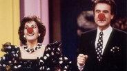 """Die Sängerin und Moderatorin Paola und Ehemann Kurt Felix mit Clown-Nasen beim Moderieren der Sendung """"Verstehen Sie Spaß?"""" 1989 © ARD"""